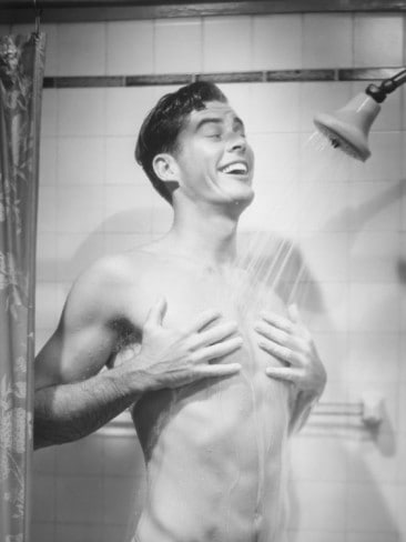 george marks mid adult man taking shower smiling